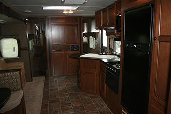 Kitchen and doors to bedroom